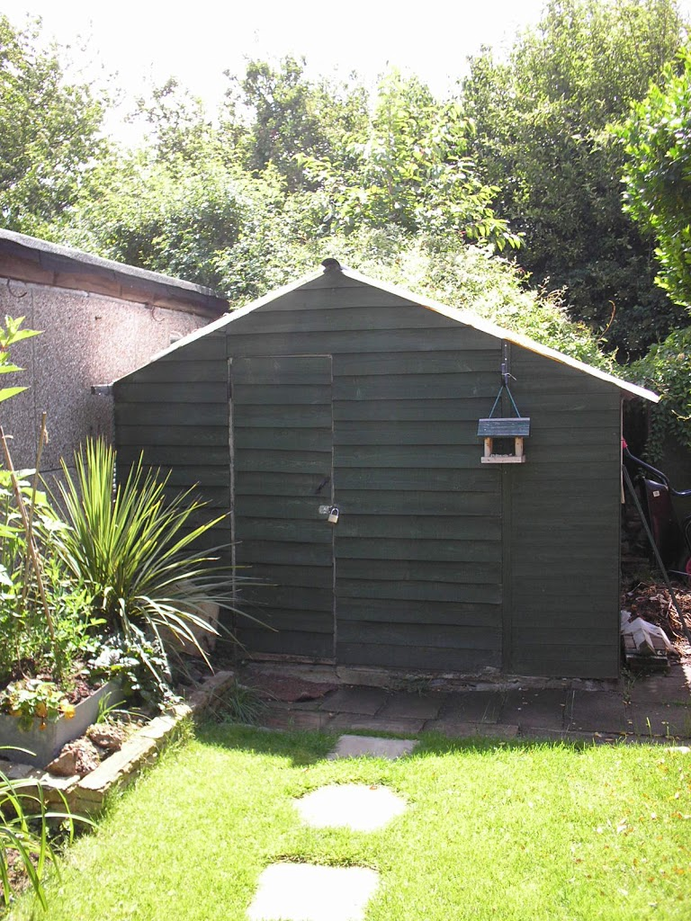 workshopshed making and repairing in a shed at the bottom of the