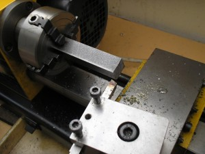 Machining one of the knurling tool arms