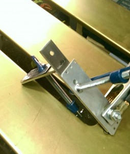 Toilet roll holder clamped up for welding