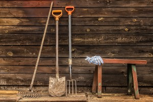 Old wooden bench garden tools against the wall