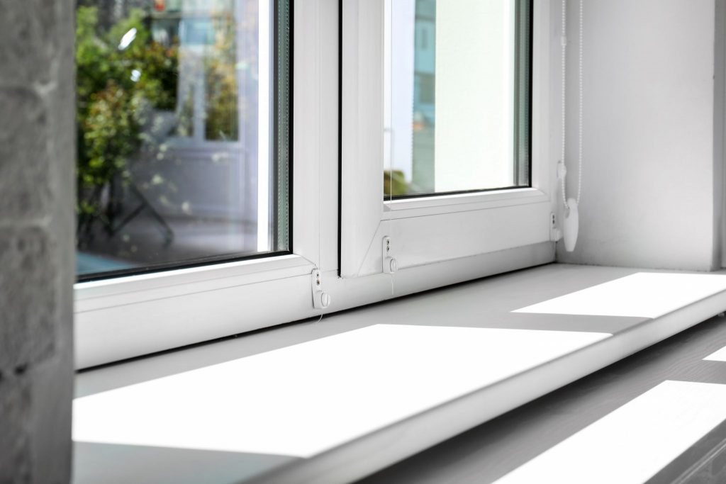 A interior view of a white window sill