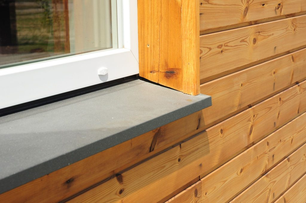 Exterior window sill for a wooden building